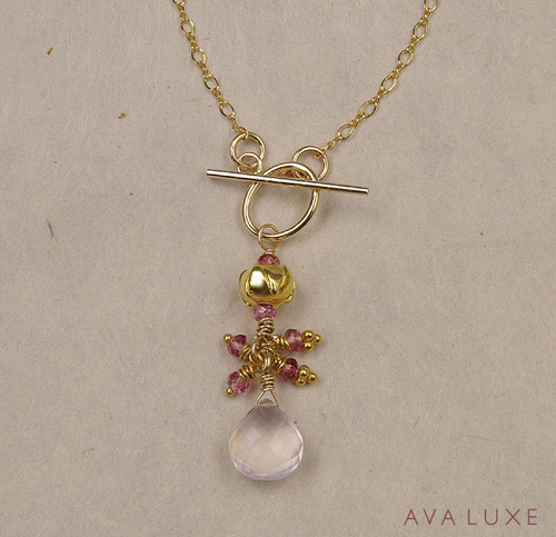 ava luxe golden lotus necklace